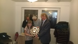 Charlie Barrett's sister receiving Charlie's Trophy.